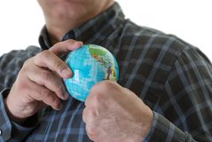 Putting the world in my pocket. Business man putting the globe in his pocket Royalty Free Stock Images