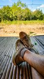 Putting your feet up on the farm. Shot on a farm in northern thailand following a days work in the rice fields. South East Asia royalty free stock photo