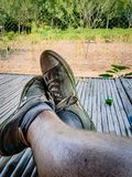 Putting your feet up on the farm. Shot on a farm in northern thailand following a days work in the rice fields. South East Asia stock photo