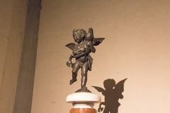 Putto with dolphin, statue by Andrea del Verrocchio in the Terrace of Juno at Palazzo Vecchio, Florence, Italy. royalty free stock photos