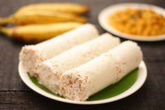 Puttu-steamed rice powder in mold with coconut Stock Photo