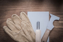 Putty knife plastering trowel and leather working gloves Stock Photos