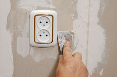 Putty near wall outlet Royalty Free Stock Image
