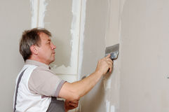 Putty plasterboard stock image
