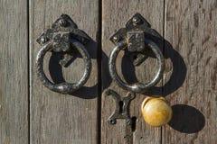 Puxador e punhos velhos Foto de Stock Royalty Free