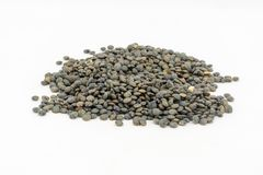 Puy Lentils. Dried puy lentils against a white background Royalty Free Stock Photos