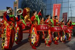 Puyang, Henan Province, China: The performance of `Battle Drum` by the women`s gongs and drums team of Shuixiu Celebration, in whi stock image