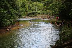 Puyo, Ecuador, 29-5-2019: Local hispanic people swimming and enjoying themself in a tropical river stock photo