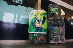 Puyo, Ecuador, 5-5-2019: Two metal bottle shaped trash bins meant for recycling plastic stock image