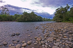 Puyo River Ecuador. Landscape scene of Puyo River flowing through the Ecuadorian jungle after sunset Royalty Free Stock Images