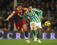 Puyol of Barcelona and Molina of Betis Royalty Free Stock Photo