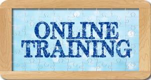 Puzzel van online opleiding in houten kader Stock Afbeelding