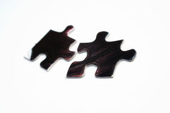 Puzzle 02. Two puzzle pieces on white background Royalty Free Stock Image