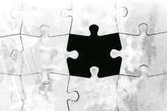 Puzzle. Grunge puzzle with missing piece Royalty Free Stock Images