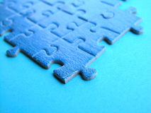 Puzzle. Blue puzzle on blue Stock Photography