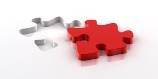 Puzzle. A red piece of a jigsaw puzzle fitting in the hole on the bottom Stock Image