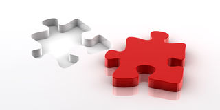 Puzzle. A red piece of a jigsaw puzzle fitting in the hole on the bottom Stock Photos