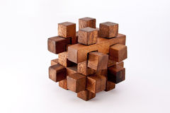 Puzzle. A wood made puzzle with a white background Royalty Free Stock Photos