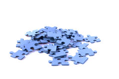 Puzzle. Blue puzzle with white background for relaxation and fun Royalty Free Stock Photography