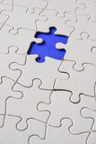 Puzzle. A blue piece of puzzle missing Stock Image