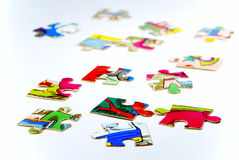 Puzzle. Spilled on a white background Stock Photos