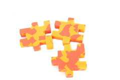 Puzzle. Three multicolored puzzles on white background Royalty Free Stock Images