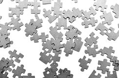 Puzzle. Grey puzzle pieces creating a texture Royalty Free Stock Images