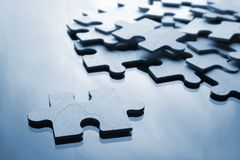 Puzzle. Assembling the puzzle piece by piece - selection Royalty Free Stock Images