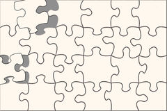 Puzzle. Almost done, blank puzzle,with the missing pieces almost in place Royalty Free Stock Photos
