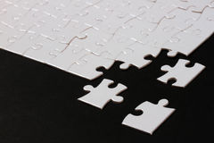 Puzzle. Pieces on black background,the missing pieces Royalty Free Stock Image