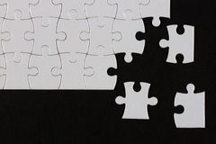 Puzzle. Pieces on black background,the missing pieces Royalty Free Stock Photo