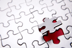Puzzle. Standing out from the crowd Stock Images