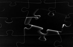 Puzzle. Without the last piece Stock Photography
