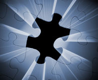 Puzzle. A photo of light emerging from a puzzle piece Royalty Free Stock Photography