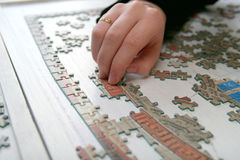Puzzle. Placing piece in puzzle Royalty Free Stock Photos