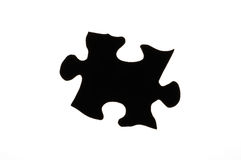Puzzle. A single black silhouetted puzzle piece Royalty Free Stock Image