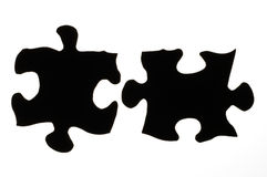 Puzzle. Two black silhouetted puzzle pieces Stock Image