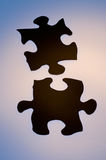 Puzzle. 2 black silhouetted puzzle pieces Stock Images