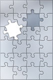 Puzzle. A metallic coloured puzzle with an absent piece Royalty Free Stock Image
