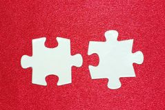 Puzzle. White puzzles isolated on a red Royalty Free Stock Photo