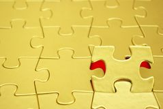 Puzzle. Gold puzzles for background. business concept Royalty Free Stock Photos