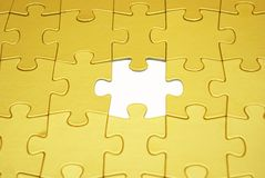 Puzzle. Gold puzzles for background. business concept Stock Photo