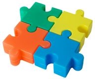 Puzzle. Plastic colored figure from slices puzzle on the white background Stock Photography