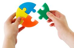 Puzzle. Hands keeping slice puzzle try its collect Royalty Free Stock Photos