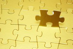 Puzzle. Gold puzzles for background. business concept Stock Images