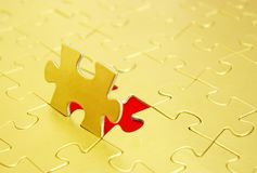 Puzzle. Gold puzzles for background. business concept Royalty Free Stock Image