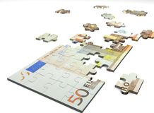 Puzzle. Note of euro as puzzle on a white background Royalty Free Stock Images