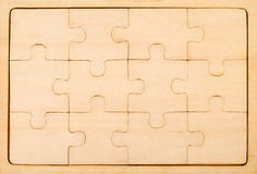 Puzzle. Close up of plain wooden jigsaw Stock Photography