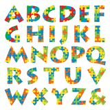 Puzzle alphabet. Vector alphabet made of puzzle in four colors Royalty Free Stock Image