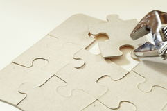 Puzzle and a apanner. Puzzle pieces Stock Photos